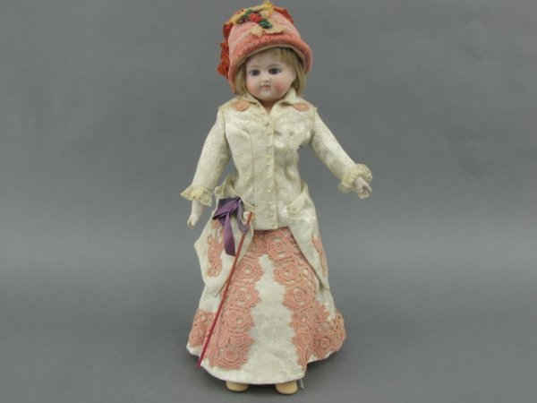 A 17 INCH FRENCH FASHION DOLL - REPAIRED