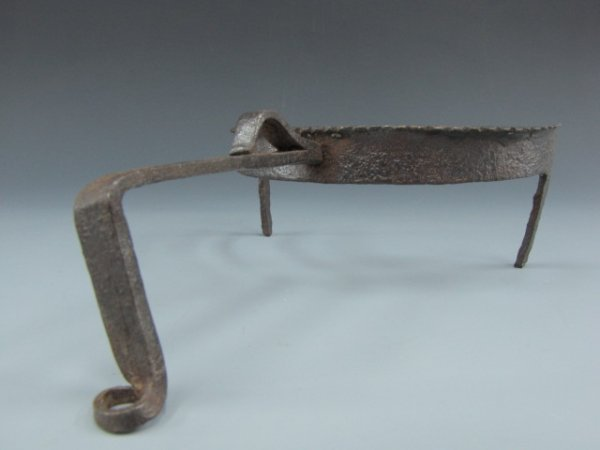 AN 18TH C. FORGED IRON POT PUSHER