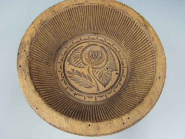 A 19TH C. WOOD BUTTER MOLD STAMP WITH FLOWERS