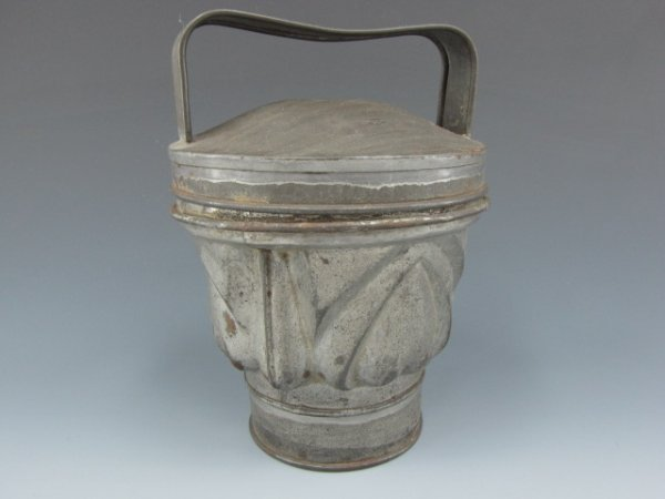 A 19TH C. STAND-UP PUDDING MOLD WITH HEARTS