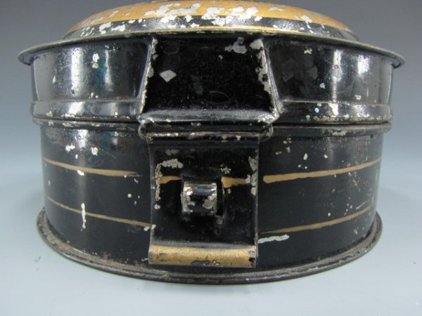 A TIN TOLE CIRCULAR SPICE BOX