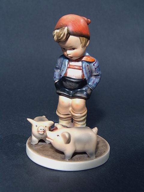"818: HUMMEL FIGURINE TITLED ""FARM BOY"" 5"", small, round"