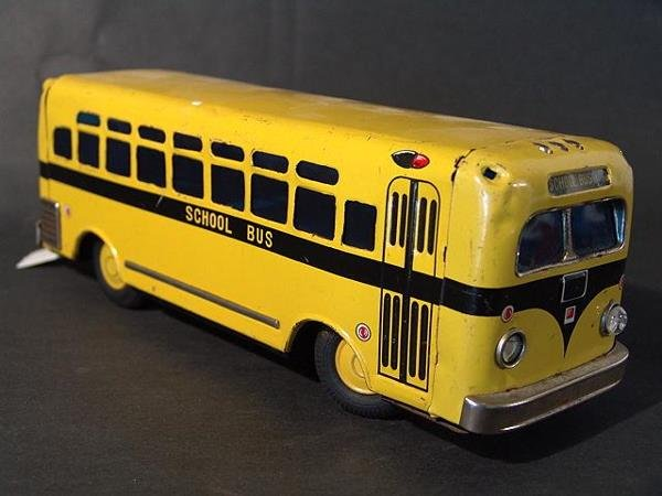 1308: JAPANESE TIN BATTERY OPERATED TOY SCHOOL BUS FLAS