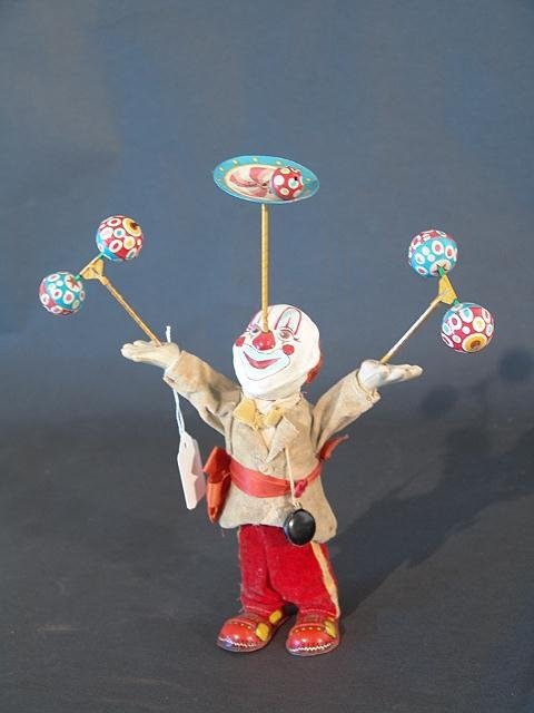 1309: JUGGLING CLOWN WIND UP TOY
