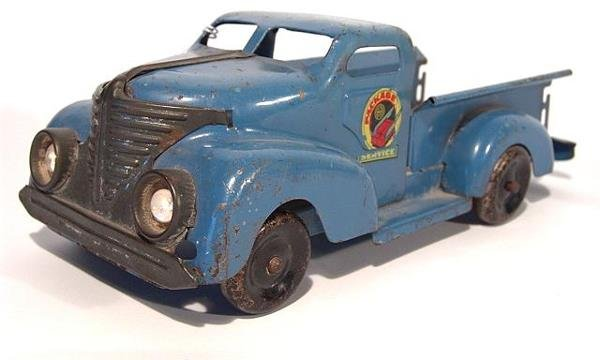 1310: MARX PACKAGE SERVICE PRESSED STEEL TRUCK WITH HEA