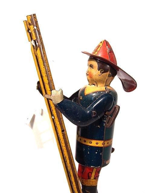 1373: MARX CLIMBING FIREMAN ON LADDER AS IS