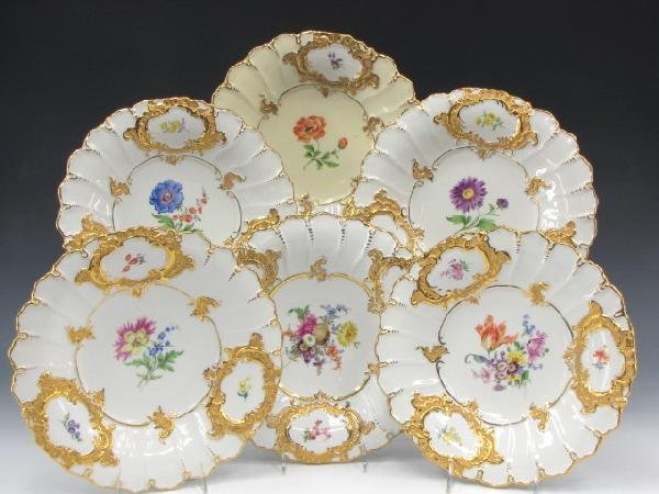 SIX MEISSEN GILT DECORATED CHARGERS WITH FLORALS