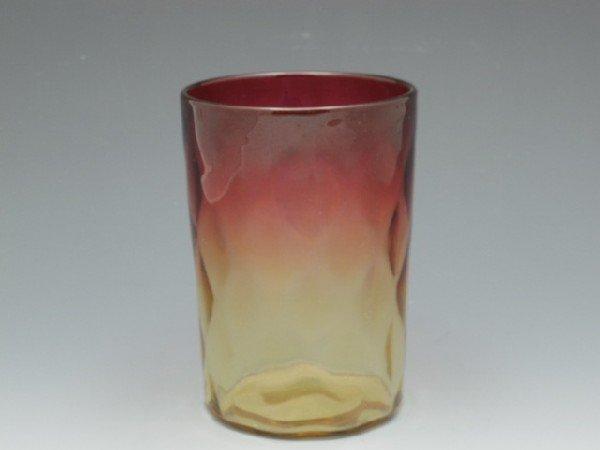 A NEW ENGLAND AMBERINA GLASS TUMBLER