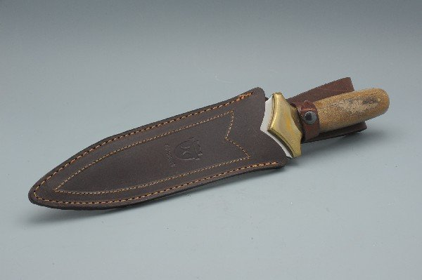 A CROWNING 440 STAINLESS KNIFE AND SHEATH