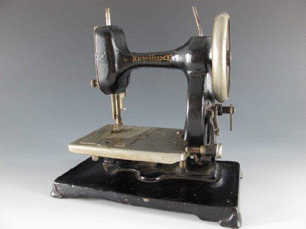 A 1912 NEW HOME MIDGET SEWING MACHINE