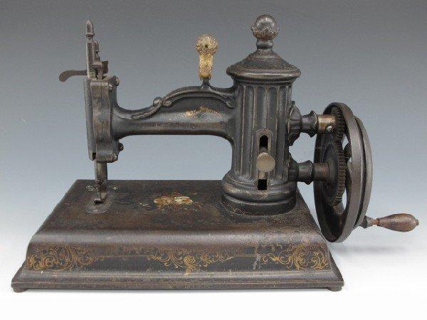 A J.G. FOLSOM GLOBE SEWING MACHINE, CIRCA 1865