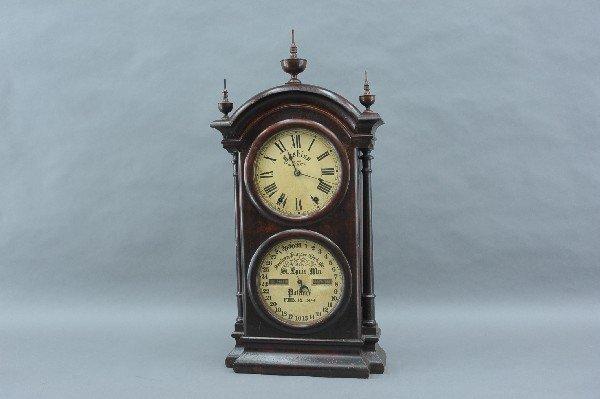 A SOUTHERN CALENDAR CLOCK CO DOUBLE DIAL CALENDAR CLOCK