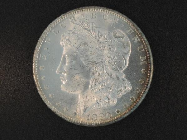 TWO UNITED STATES SILVER DOLLARS: 1880S & 1880