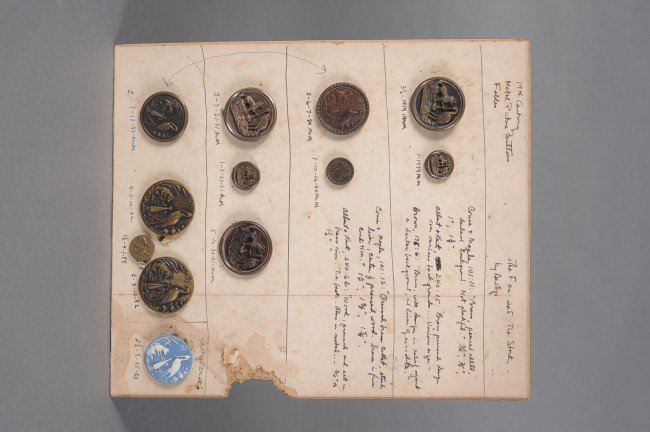 11A: ELEVEN FIGURAL METAL BUTTONS AND ONE WEDGWOOD JASP
