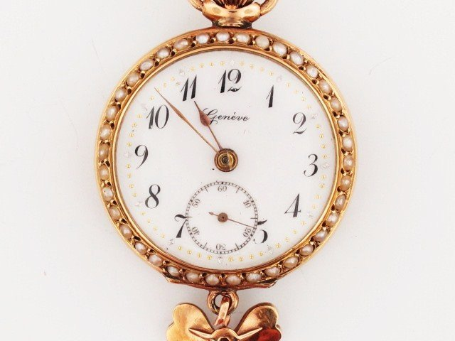 18: A GENEVE 14K  PENDANT WATCH WITH SEED PEARLS