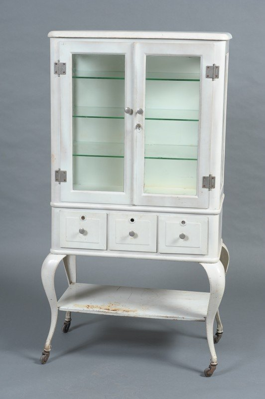 AN ANTIQUE WHITE METAL MEDICAL CABINET