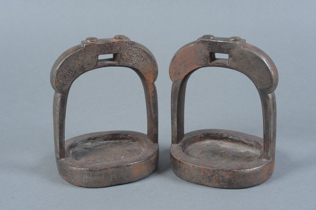 A PAIR OF JAPANESE STIRRUPS WITH BUDDHIST SYMBOLIC DESI