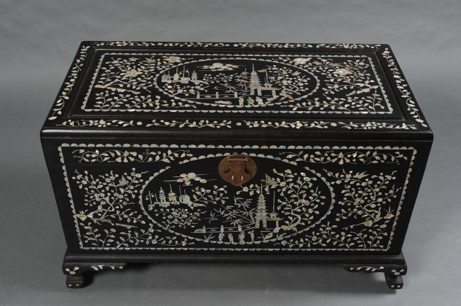AN ASIAN TEAK CHEST WITH PEARL INLAYS