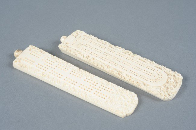 A PAIR OF CARVED IVORY CRIBBAGE BOARDS