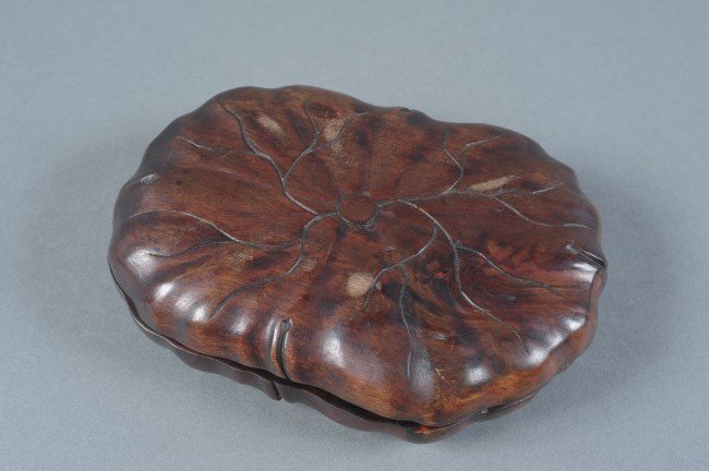 A 19TH C. CHINESE DUAN INKSTONE IN LOTUS CASE