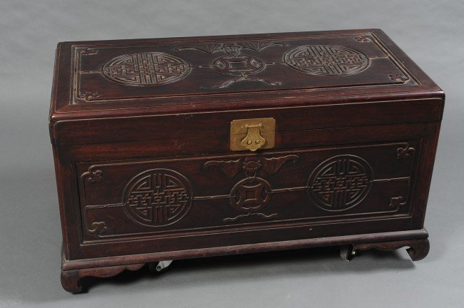 AN ASIAN CARVED WOOD CHEST