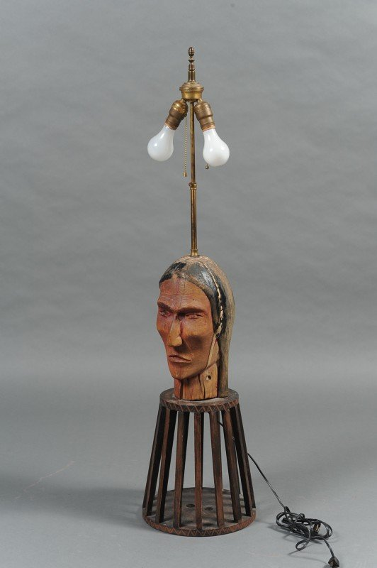 A FOLK ART CARVED WOOD INDIAN HEAD TABLE LAMP