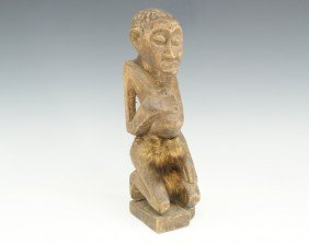 CARVED WOOD AFRICAN FETISH FIGURE WITH FUR