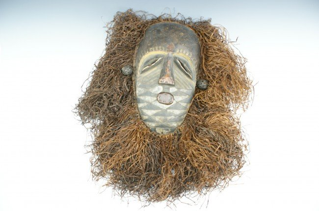 A CARVED WOOD AFRICAN MASK, ZAIRE