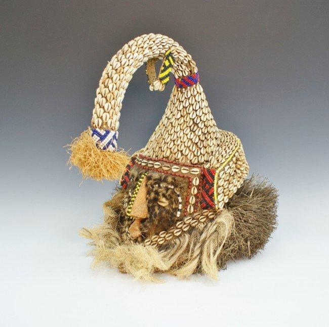 AN AFRICAN BAKUBA COWRIE HEADDRESS