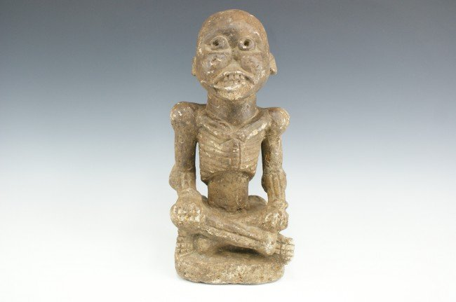 A CARVED STONE AFRICAN FETISH