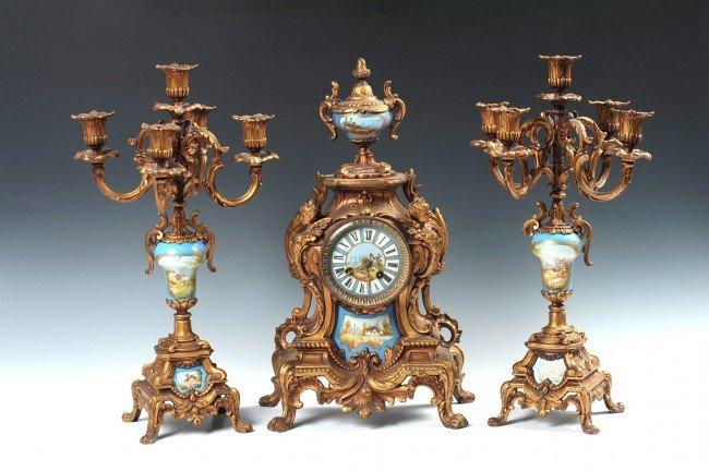 A JAPY FRERES LOUIS XVI CLOCK SET WITH PORCELAIN