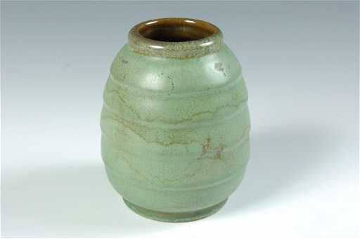 A Frankoma Pottery Vase With Pacing Leopard Mark