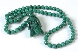 A CHINESE CARVED MALACHITE NECKLACE AND PENDANT