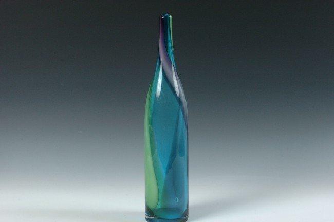 A MODERN DESIGN BLOWN GLASS BOTTLE