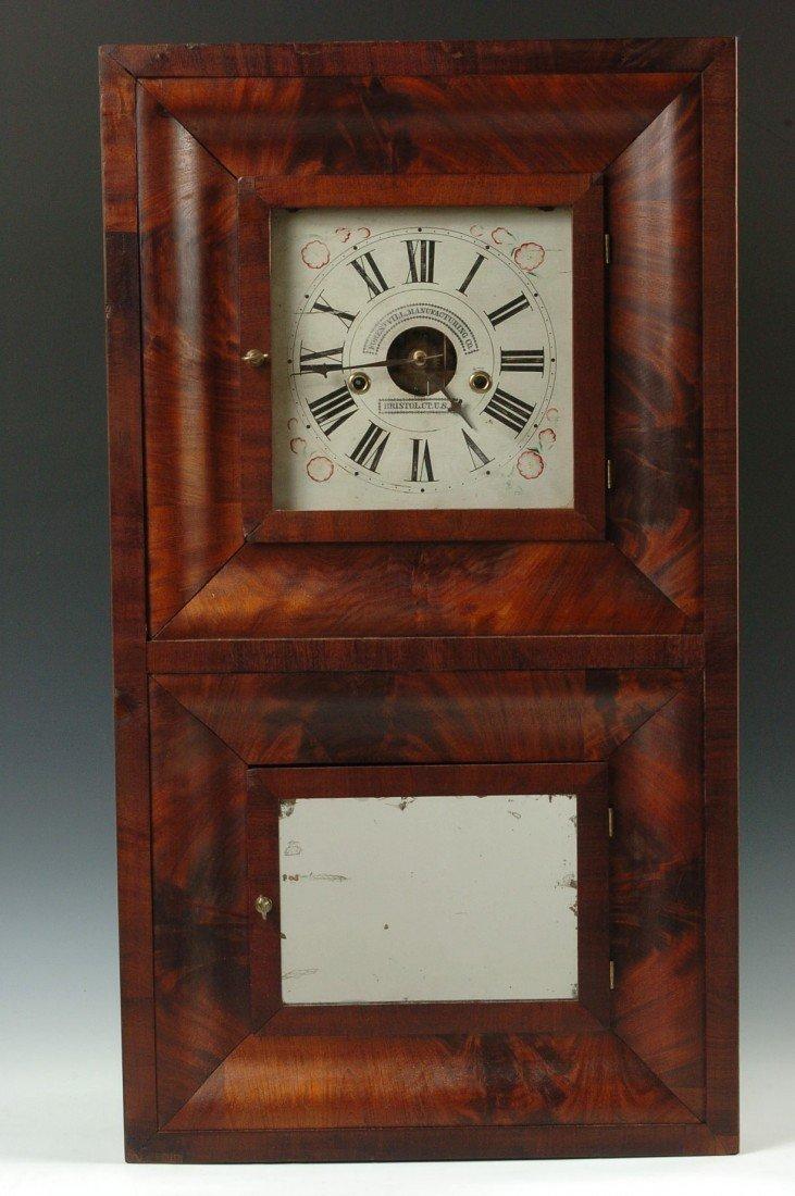 A FORESTVILLE TWO DOOR OGEE SHELF CLOCK 1849-1853