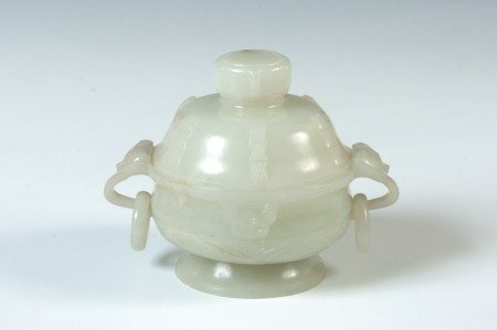 A CHINESE CARVED JADE LIDDED JAR