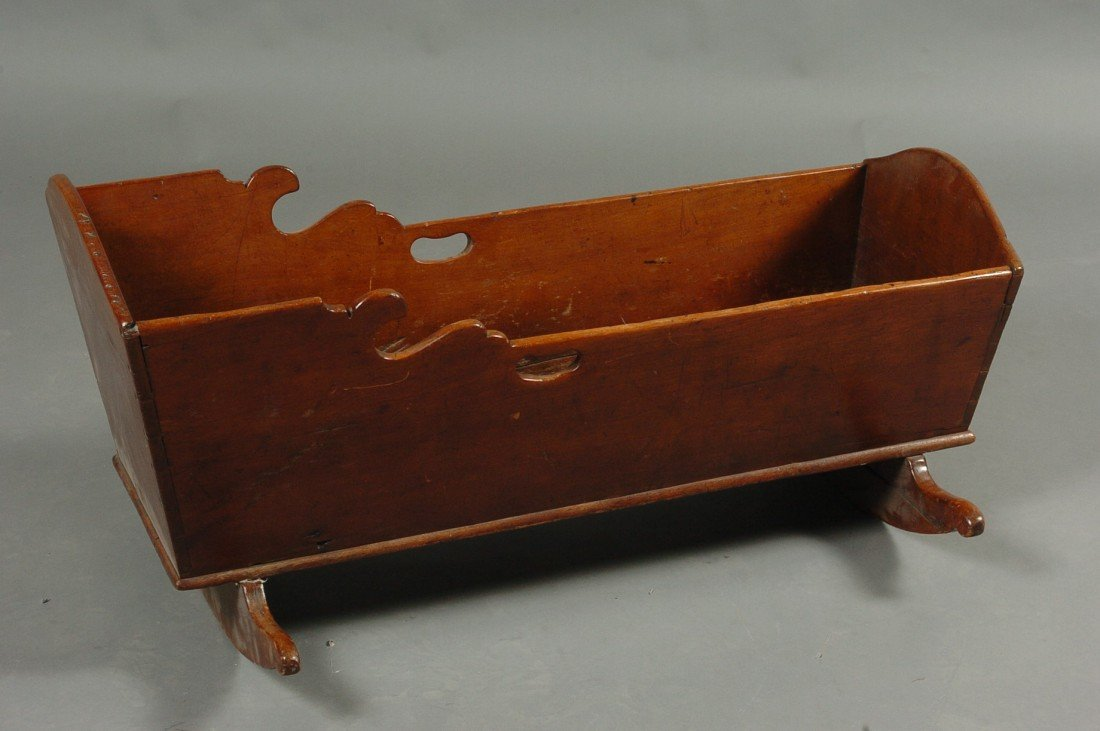 A 19TH CENTURY AMERICAN DOVETAILED BABY CRADLE