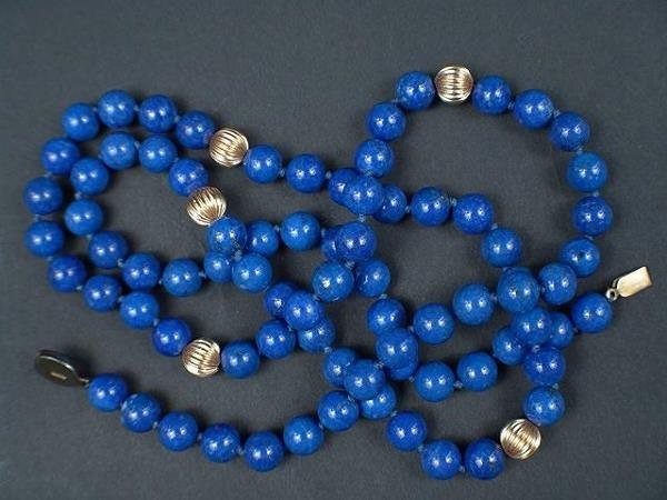 316: OPERA LENGTH STRAND LAPIS BEADS AND FLUTED GOLD BA