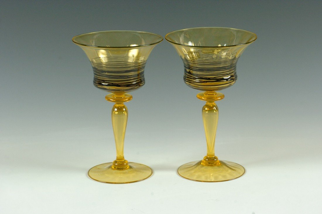 A PAIR OF STEUBEN THREADED GLASS GOBLETS