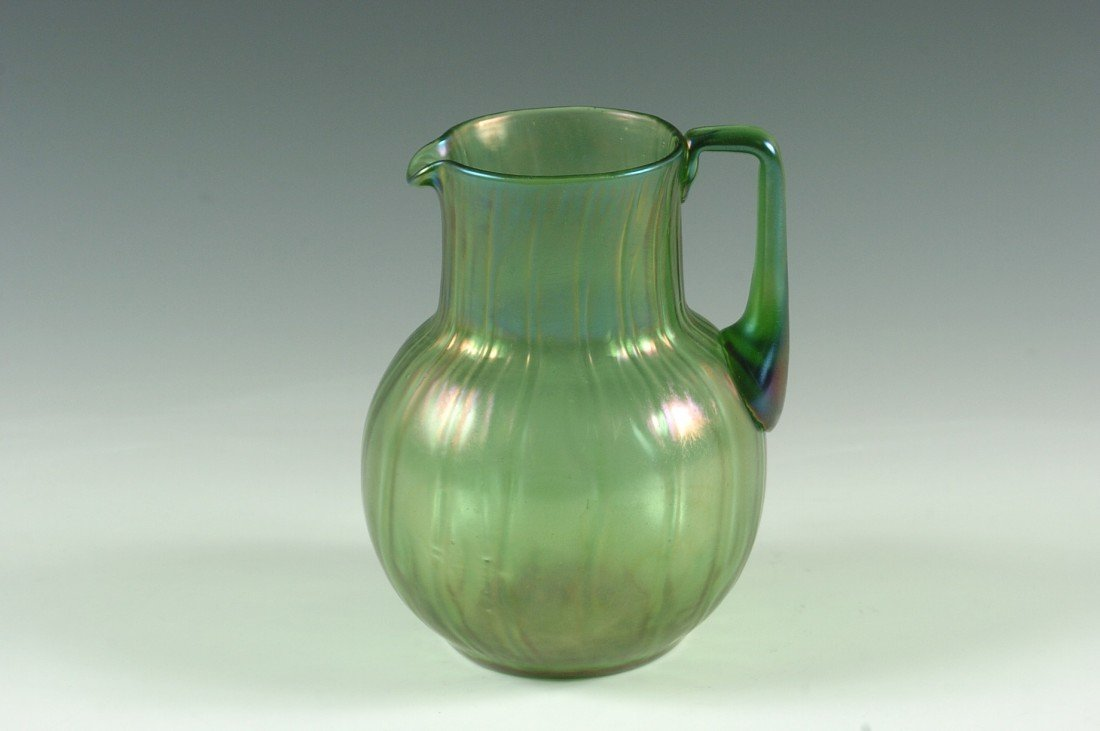 AN AUSTRIAN ART GLASS PITCHER WITH POLISHED PONTIL