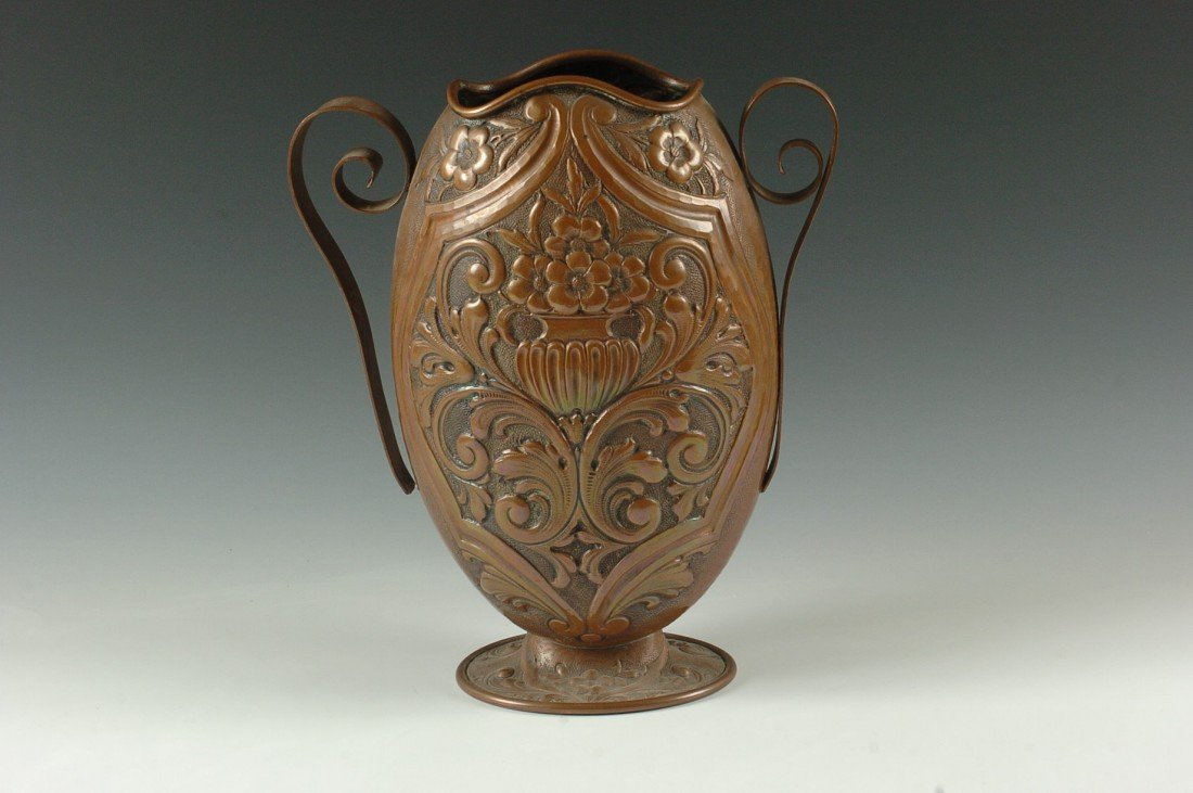 A GREAT HAMMERED AND REPOUSEE COPPER VASE