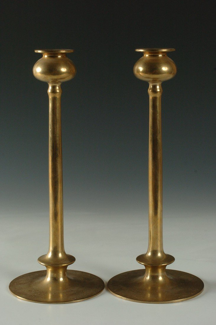 A PAIR OF BRASS CANDLESTICKS MANNER OF JARVIE