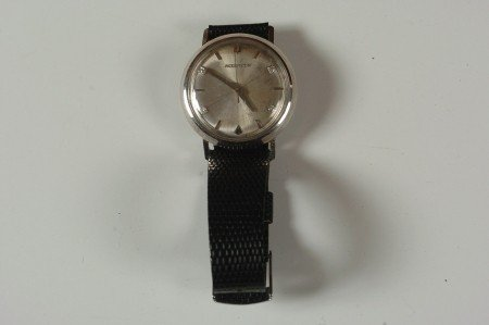 A BULOVA ACCUTRON MEN'S WRISTWATCH WITH DIAMONDS