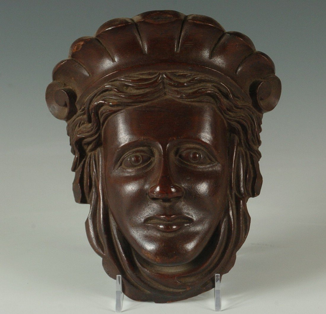 A 19TH C. CARVED WALNUT COLUMBIA HEAD WALL POCKET