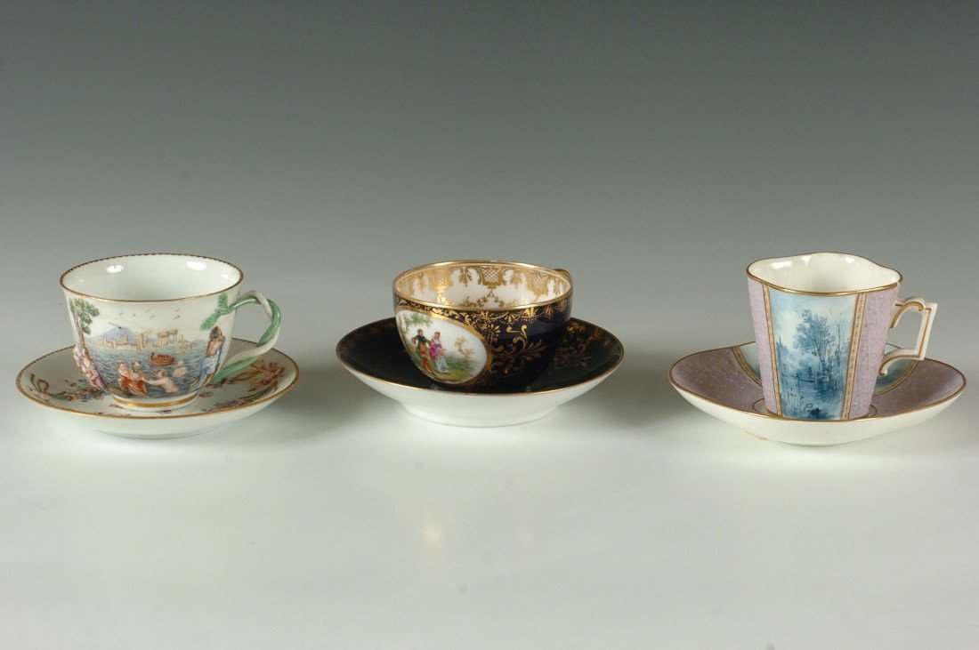 THREE CABINET CUP AND SAUCER SETS