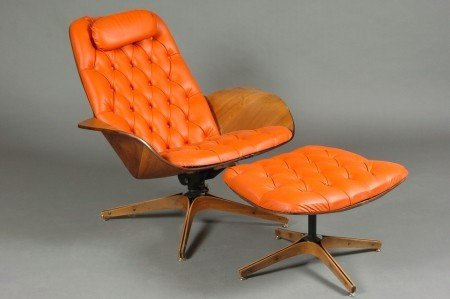 A PLYCRAFT LOUNGE CHAIR AND OTTOMAN