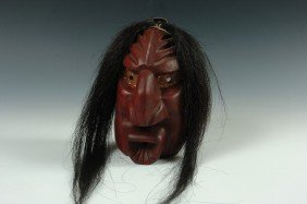 AN IROQUOIS CARVED WOOD MASK