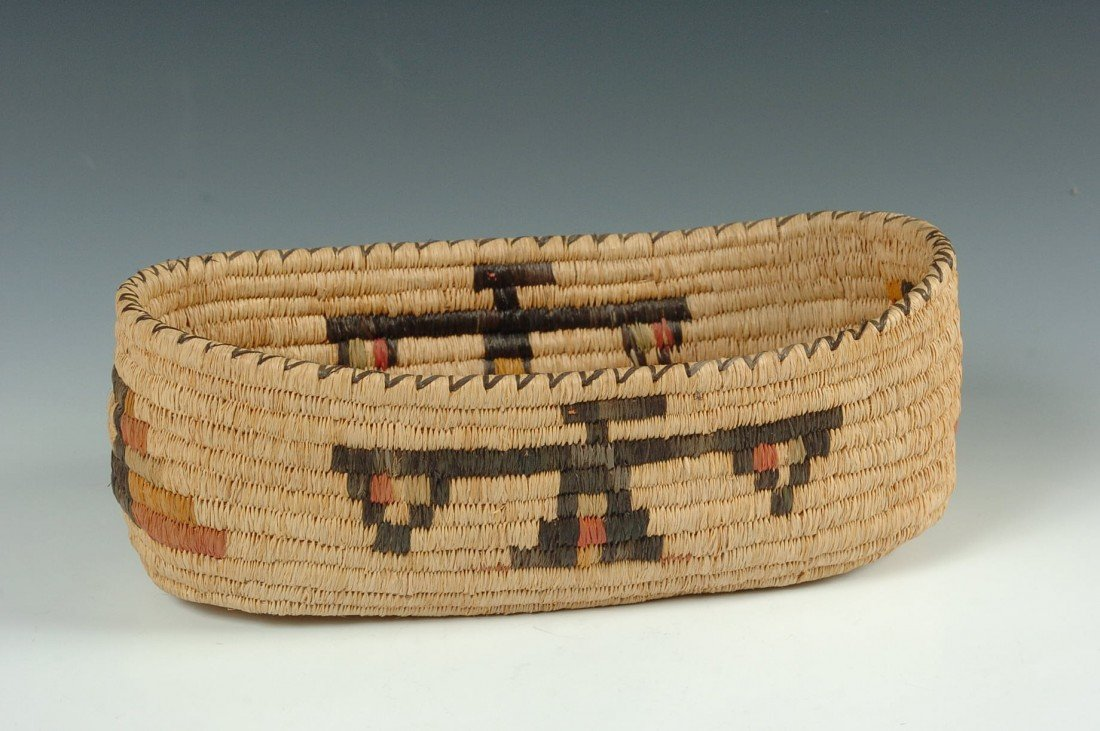 SKOKOMISH BOAT SHAPE BASKET WITH THUNDERBIRDS