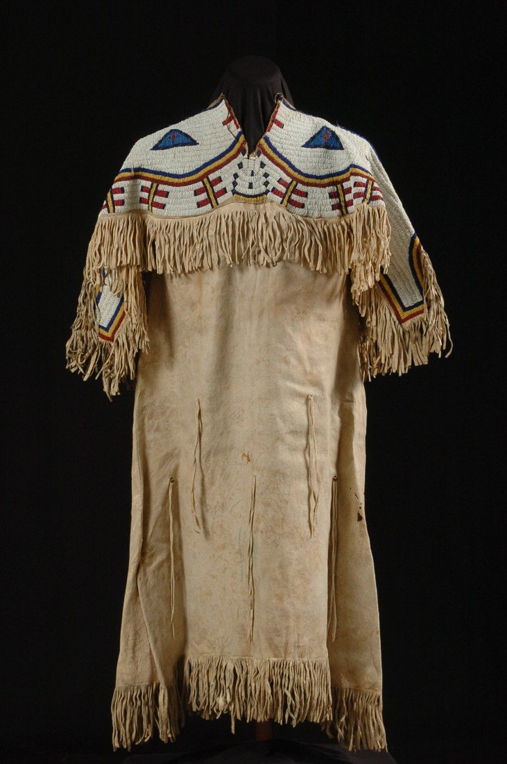 A SIOUX BEADED AND FRINGED HIDE DRESS CIRCA 1890