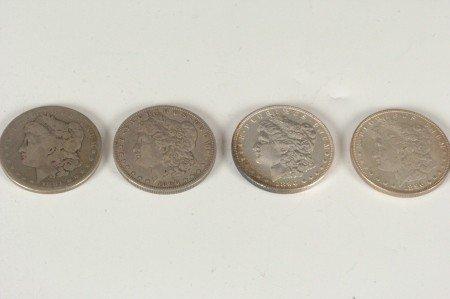 1: LOT OF FOUR MORGAN SILVER DOLLARS